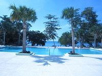 CHARMING 2 BEDROOM HOME 3 BEDS SLEEPS 2-6 24hr SECURITY PRIVATE POOL BEACH