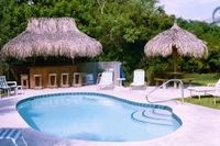 One bedroom beach cottage sleeps four steps to the sand pool Tiki Bar