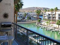 Riverfront Condo - Marina River view - pool spa - boat slips
