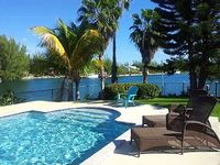 Beautiful waterfront home with pool private boat and Jet Ski
