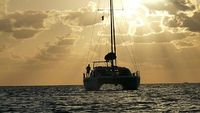 Charter a private catamaran to sail you to the most beautiful spots in the world