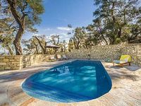 Villa Lenio enjoy fine views over the olive trees to the Ionian sea