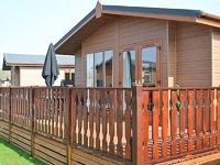 A welcoming ground floor South Lakeland log cabin with on-site facilities including swimming pool gym spa and bar WiFi En-suite bedroom Great touring base Carnforth 2 miles