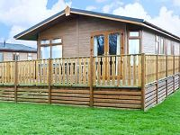 Welcoming single-storey South Lakeland log cabin in leisure village with swimming pool gym bar restaurant Close to lake ideal year-round base Carnforth 2 miles