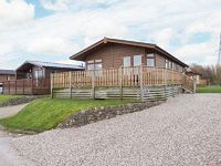 Cosy detached South Lakeland log cabin in leisure village Use of swimming pool steam room gym Balcony view towards lake Carnforth 2 miles