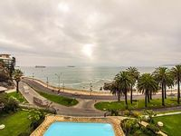 Large oceanfront condo with a balcony shared pool across from the beach