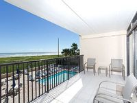 2 bedroom condo over the pool area with a great beach view
