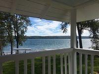 Owasco Lake front seasonal cottage with level yard and beach