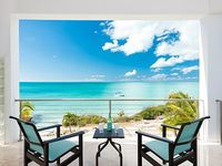 A two bedroom two bath oceanfront villa on with stunning views of Sapodilla Bay