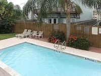 Upgraded condo w shared pool only a 1 2 block from the beach