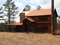 This spacious three-bedroom two-story cabin accommodates 6-8 guests in more tha