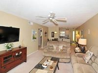 Great Siesta Beach View End unit with open kitchen Fans See the sunset here for your vacation
