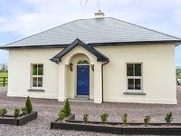 This well-finished detached house is situated in the County Cork countryside outside the small village of Carrigadrohid near Macrrom and can sleep nine people in three bedrooms