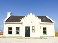 This detached house is very close to the coast in Dugort on the ever-popular Achill Island County Mayo and sleeps eight people over two floors in four bedrooms