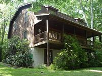 Located At Deep Creek Lake This Log Home Features A Hot Tub On A Covered Porch