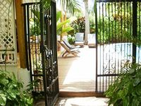 charming villa Caribbean beautiful beach nearby swimming pool enclosed tropical garden
