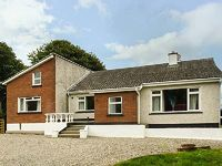 A detached holiday home in rolling countryside two miles from Curracloe County Wexford sleeping eight people in four bedrooms
