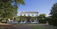 A majestic 3 bedroom manor house set on a boutique vineyard surround by mountain