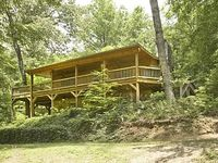 3BR 3BA Cabin Sitting On 10 Secluded Acres With A Private Lake WiFi Wood Burning Fireplace Charcoal Grill Satellite TV and King Bed In Master With French Doors Opening Up To A Private Hot Tub