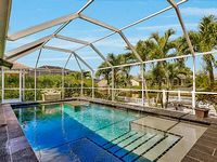 Stunning Gulf Access Pool Home on Royal Palm lined Cul De Sac