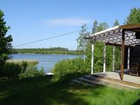 Cottage with private jetty and boat in a quiet location