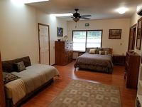 spacious bedroom with 1 queen and 1 twin bed own private bathroom