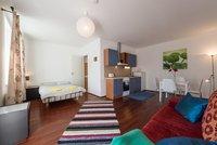 Propre et confortable appartement avec terrasse II