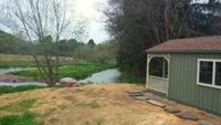 Cabin overlooking Del River on working Dairy Farm