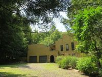 4 bedroom 3 5 bath home on four-acre wooded estate next to Butternut Mountain