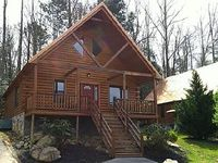 Located in a resort community close to the Golf Course 3 bedroom log home with Hot Tub Jacuzzi FP