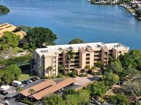 Chinaberry 942 - 2 Bedroom Condo with Private Beach with lounge chairs umbrella provided 2 Pools Fitness Center and Tennis Courts