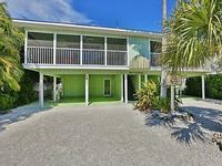 Walk to the Beach and More from this Fully Renovated Unit W Heated Pool