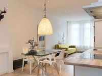 Trendy studio apartment with canal views and a garden for a couple located in Amsterdam s authenti