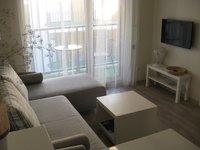 Un appartement avec une chambre