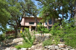Romantic straw bale home on lake travis in spicewood tx for Straw bale house cost per square foot